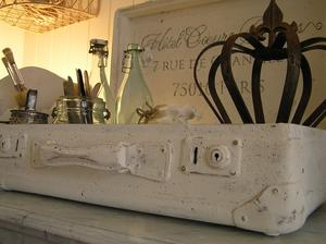 Old white distressed suitcase with french text
